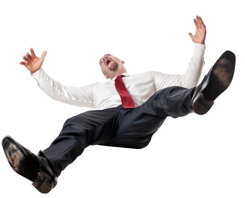 Homem que cai para baixo foto de stock