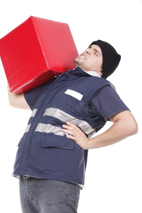 Homem que carreg o cubo vermelho imagens de stock royalty free