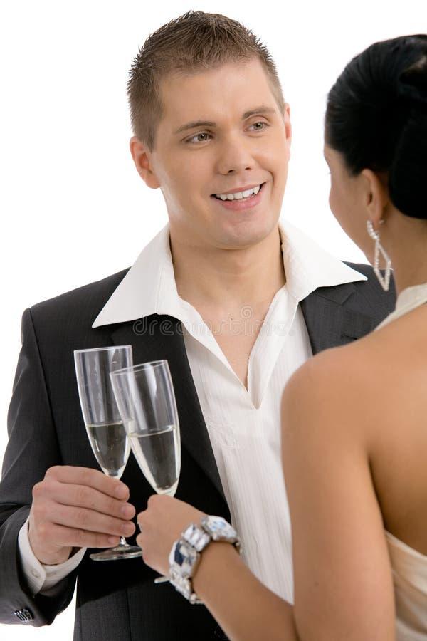Homem que clinking com champanhe fotografia de stock