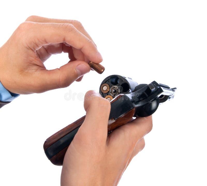 Homem que cobra uma pistola imagem de stock royalty free