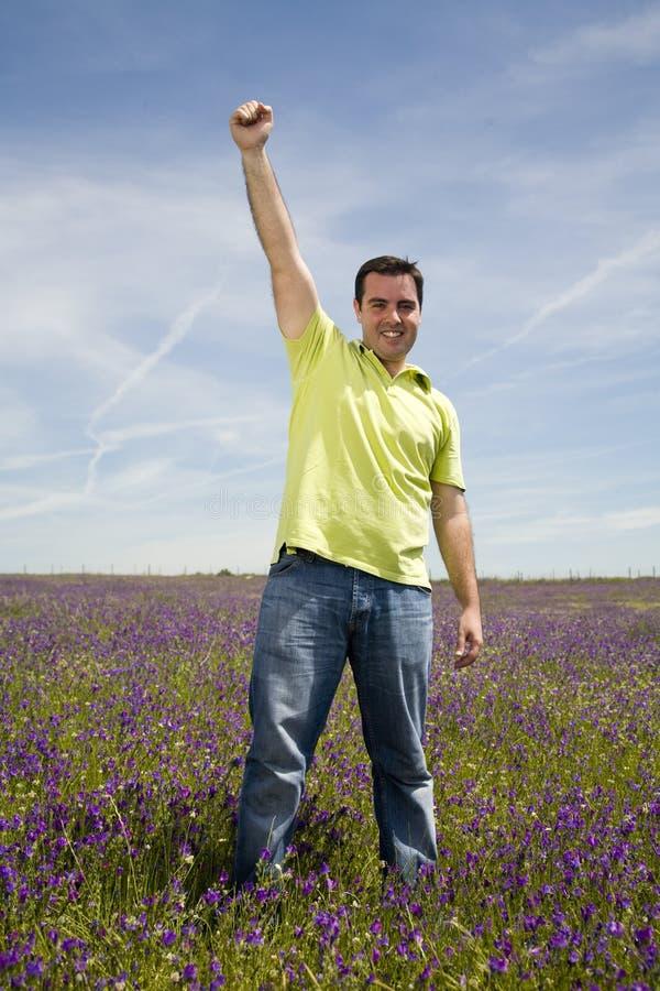Homem que comemora o sucesso fotografia de stock royalty free