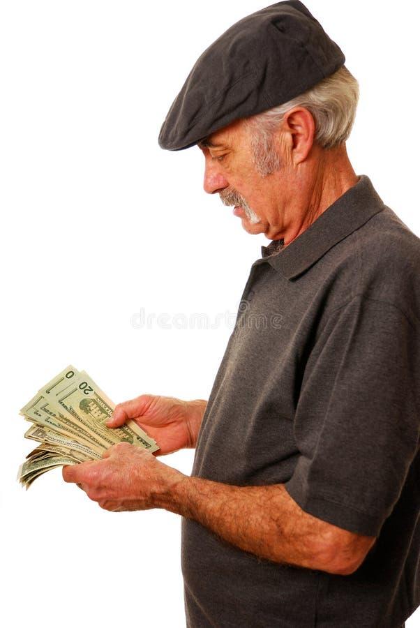 Homem que conta dólares foto de stock royalty free