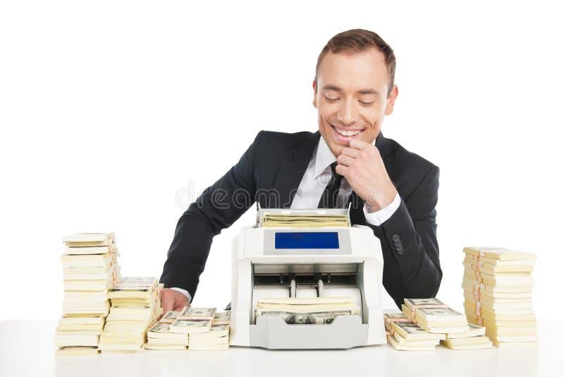 Homem que conta o dinheiro. fotos de stock royalty free