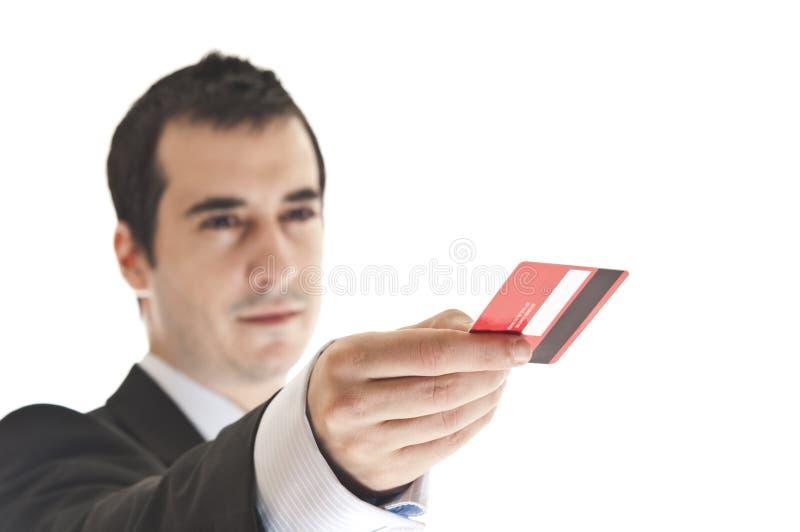 Homem que dá o cartão de crédito fotos de stock