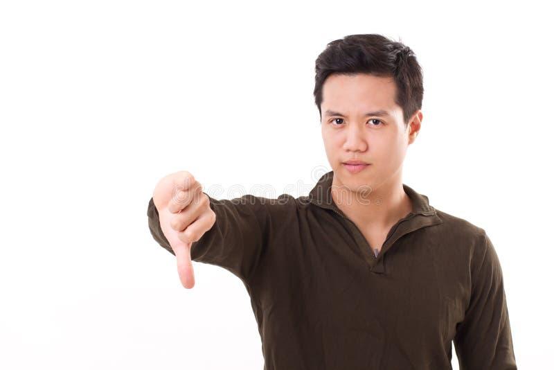 Homem que dá o polegar para baixo, gesto da rejeção foto de stock royalty free