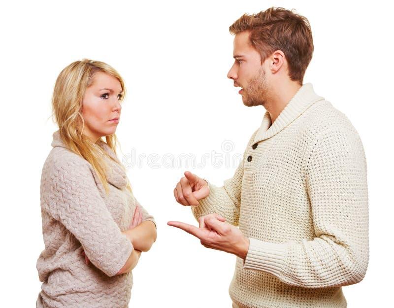 Homem que discute com a mulher fotografia de stock royalty free