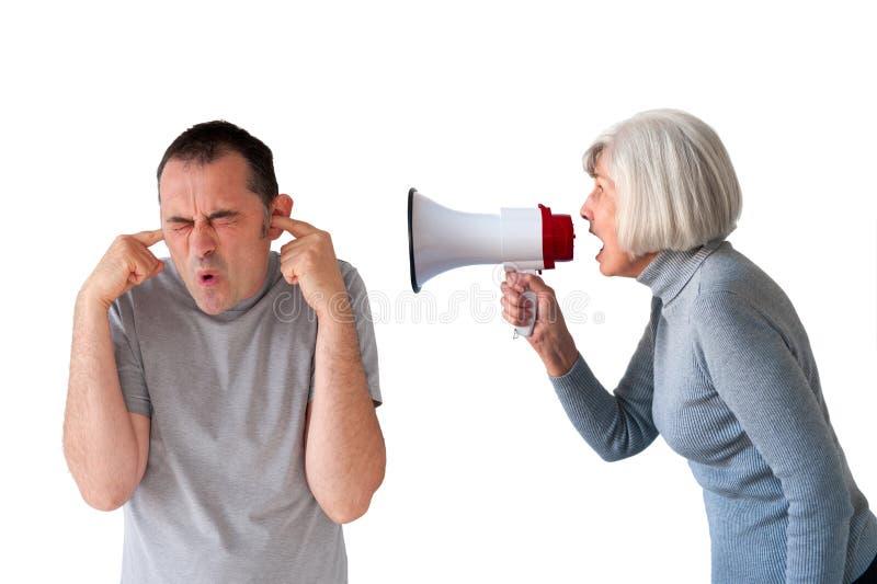 Homem que está sendo gritado pela mulher superior fotos de stock royalty free