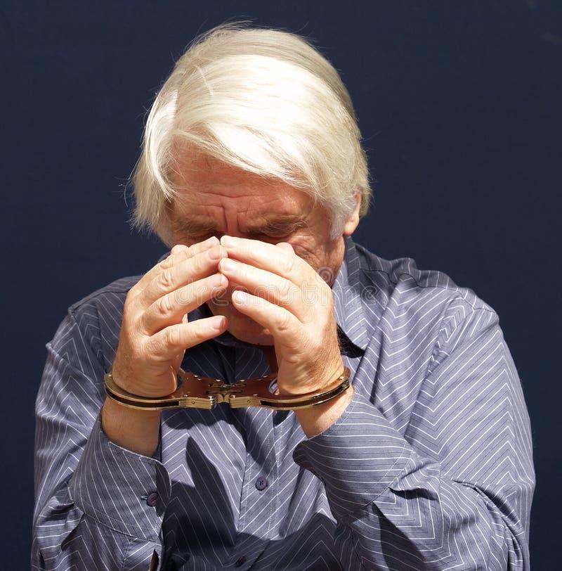Homem que está sendo prendido imagens de stock royalty free