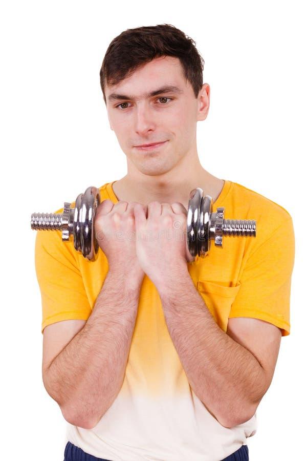 Homem que exercita com levantar peso dos pesos imagem de stock