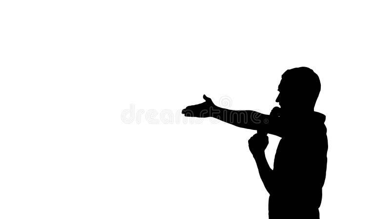 Homem que fala no microfone no fundo branco imagens de stock royalty free