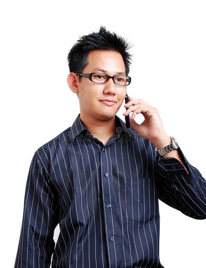 Homem que fala no telefone imagens de stock royalty free