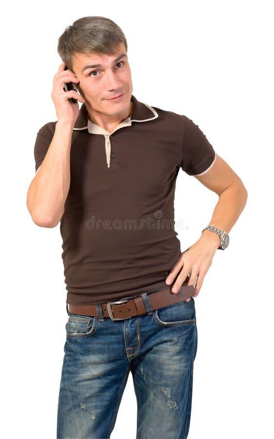 Homem que fala no telefone celular. imagem de stock royalty free