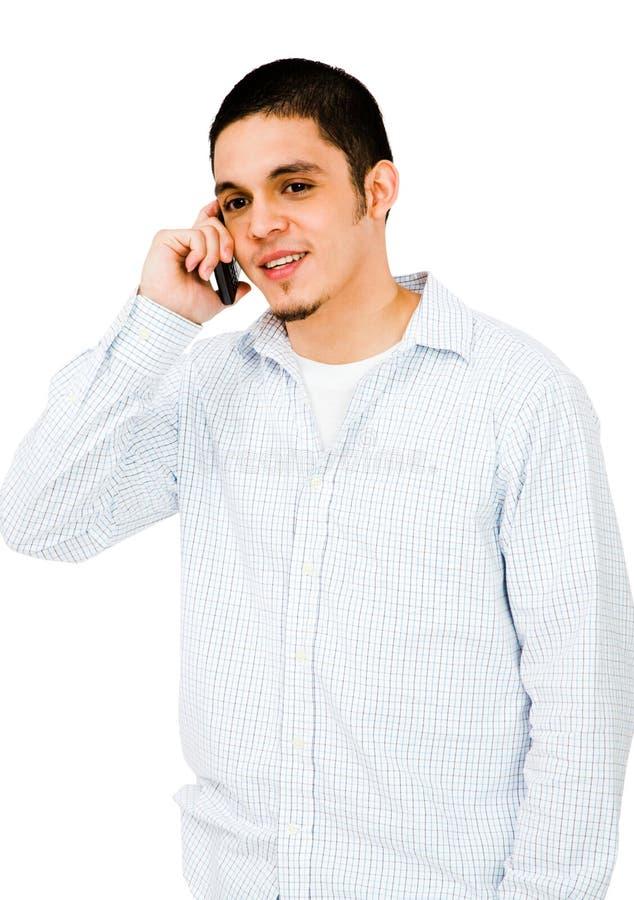 Homem que fala no telefone móvel imagem de stock