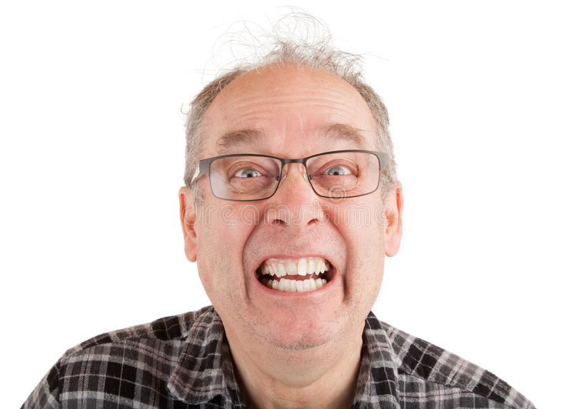 Homem que faz as faces engraçadas imagens de stock royalty free