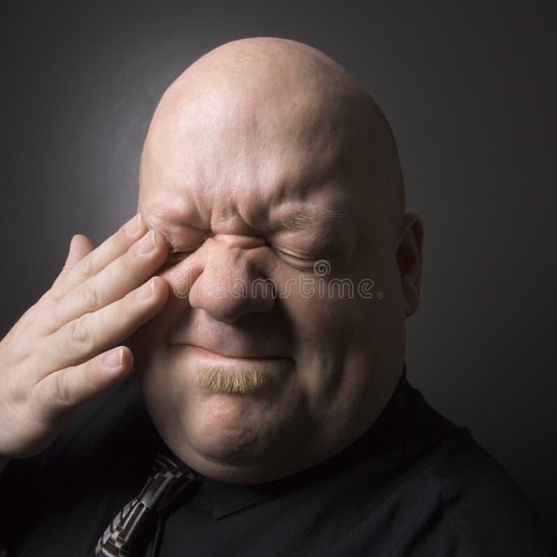 Homem que faz a expressão facial. fotografia de stock