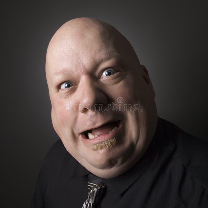 Homem que faz a expressão facial. imagens de stock
