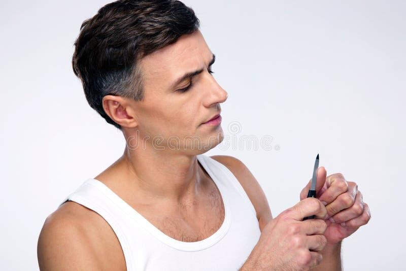 Homem que faz o tratamento de mãos imagem de stock royalty free