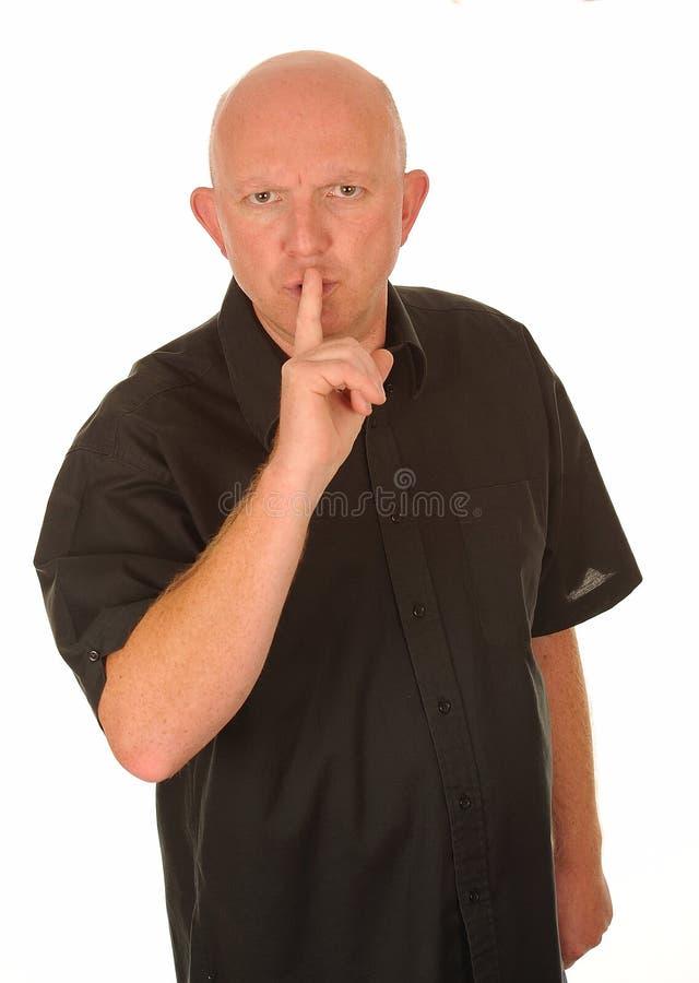 Homem que gesticula para o quiet imagens de stock royalty free