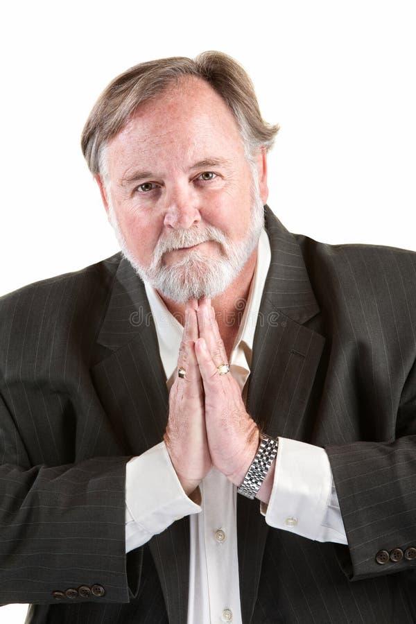 Homem que gesticula para pray imagem de stock royalty free