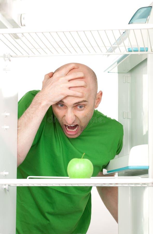 Homem que grita na maçã imagens de stock royalty free