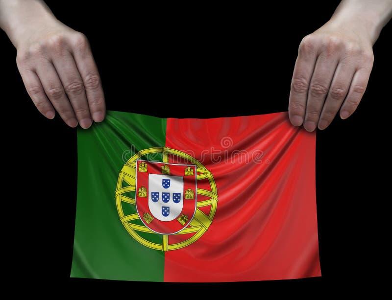 Homem que guarda a bandeira portuguesa foto de stock royalty free