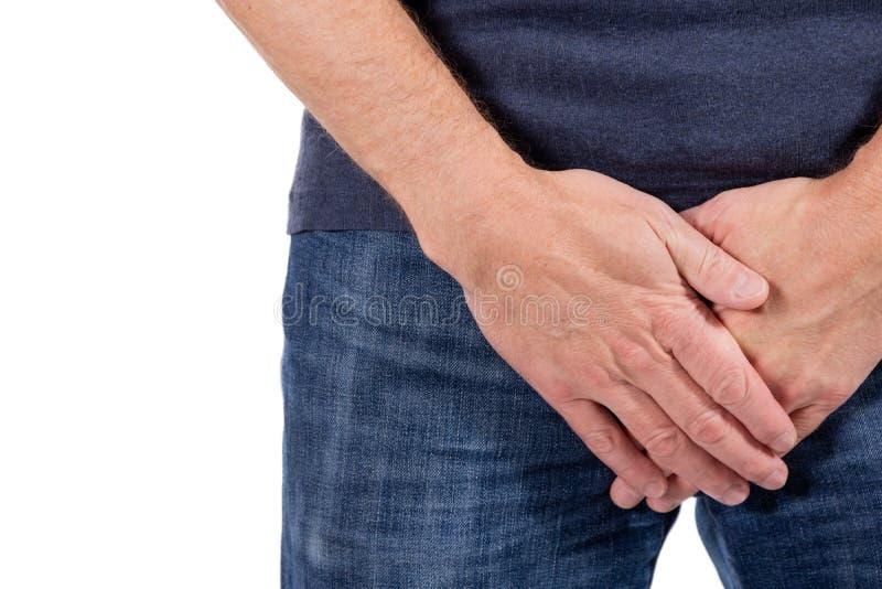 Homem que guarda sua uretra na dor Problemas dos homens no fundo branco Conceito MÉDICO fotos de stock royalty free