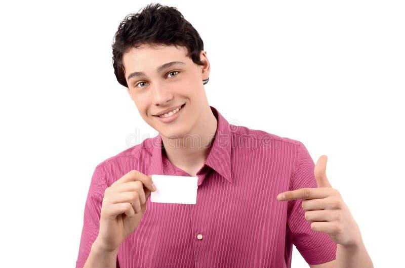 Homem que guardara e que aponta a um cartão. imagens de stock royalty free