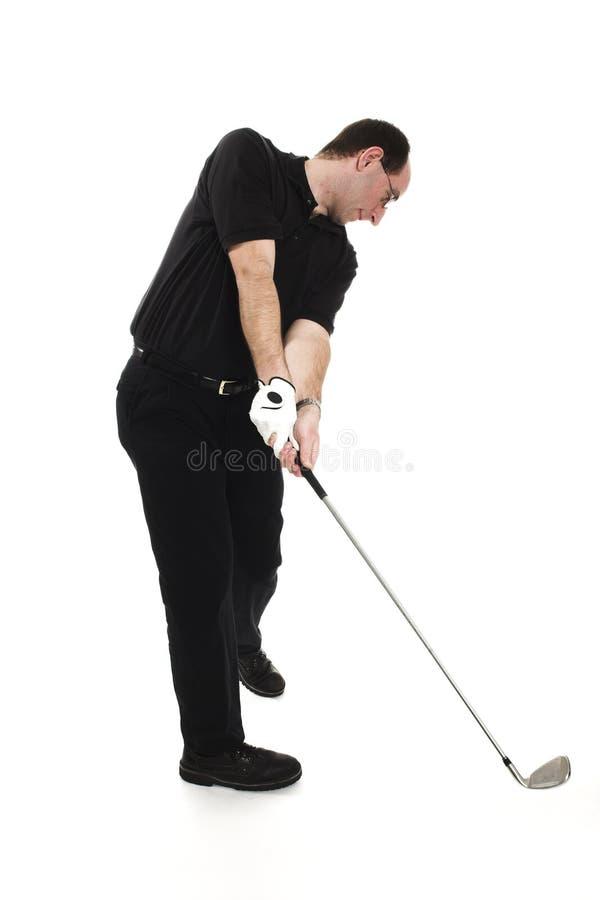 Homem que joga o golfe foto de stock