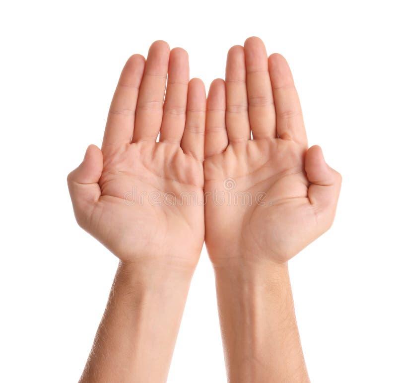 Homem que mostra as mãos no fundo branco foto de stock royalty free