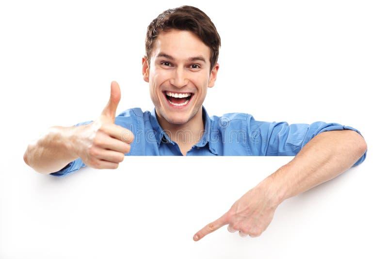 Homem que mostra os polegares acima com placa vazia imagens de stock