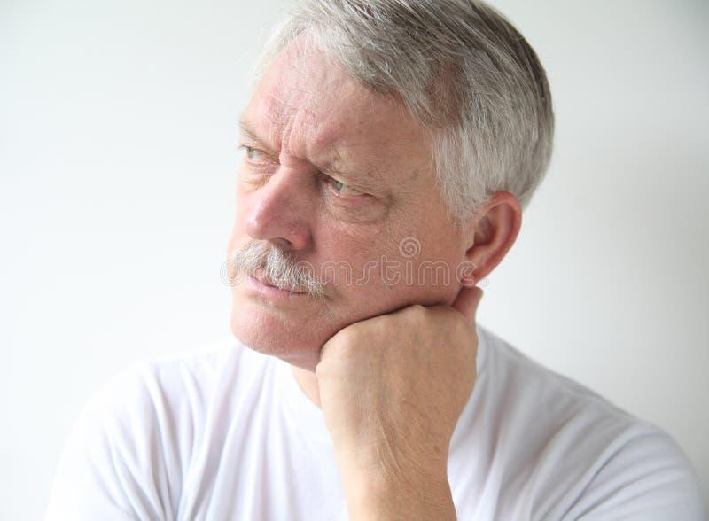 Homem que olha irritado fotografia de stock