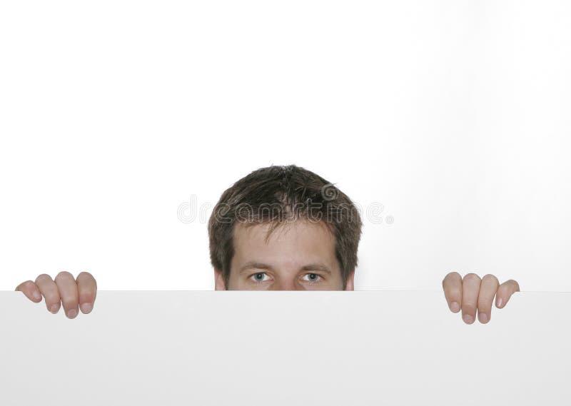 Homem que olha sobre a borda imagens de stock royalty free