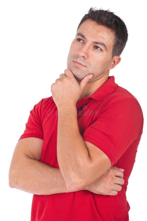 Homem que pensa com mão em seu queixo fotografia de stock