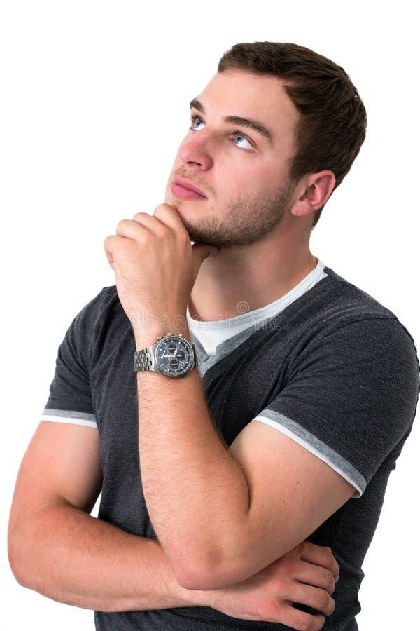 Homem que pensa e que olha acima fotos de stock royalty free