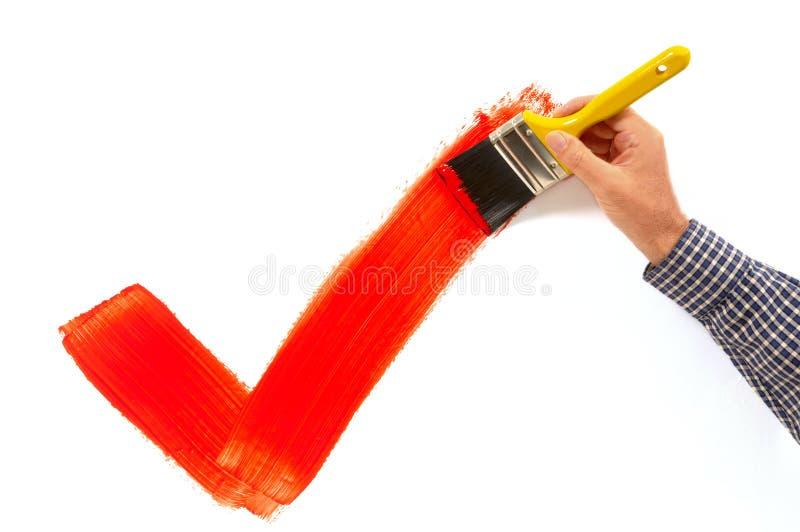 Homem que pinta o tiquetaque vermelho imagens de stock royalty free