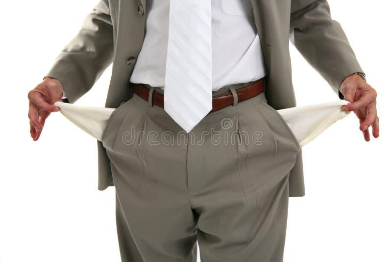 Homem que retira bolsos vazios fotografia de stock