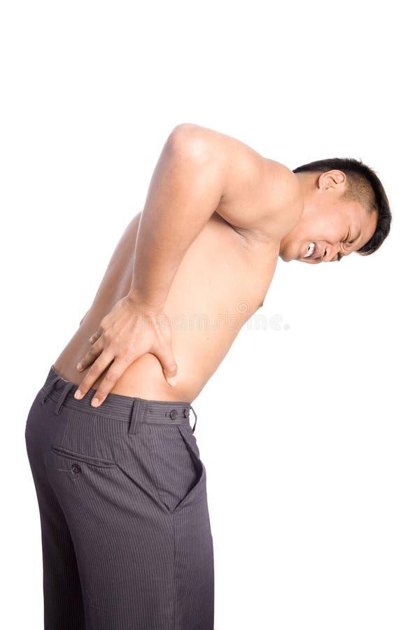 Homem que sofre da dor traseira fotografia de stock