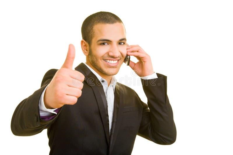Homem que usa o telefone de pilha fotografia de stock