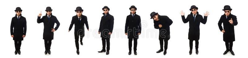 Homem que veste o revestimento preto isolado no branco imagem de stock royalty free