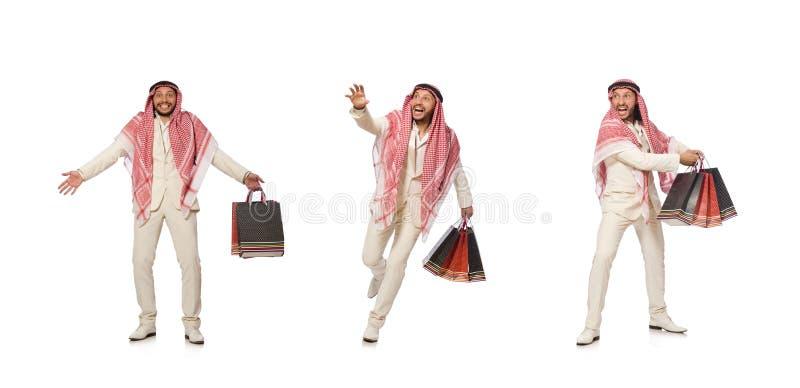 Homem ?rabe com os sacos de compras no branco imagem de stock royalty free