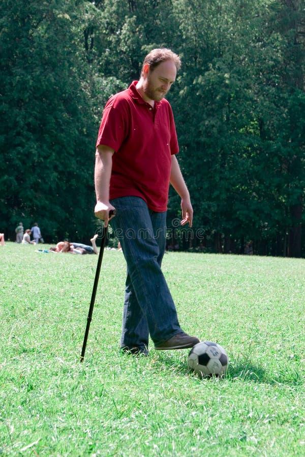 Homem-roda com uma vara fotos de stock royalty free