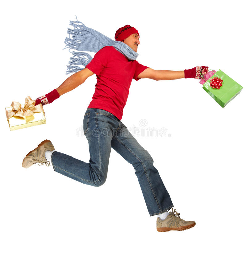 Homem running feliz com presentes do Xmas fotografia de stock royalty free