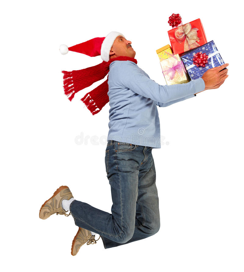 Homem running feliz com presentes do Xmas fotografia de stock