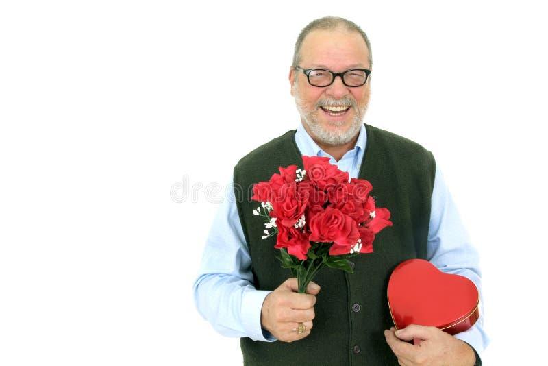 Homem sênior com flores fotografia de stock royalty free