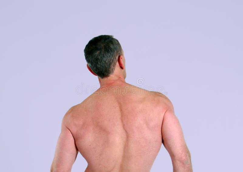 Homem sênior com parte traseira muscular fotos de stock