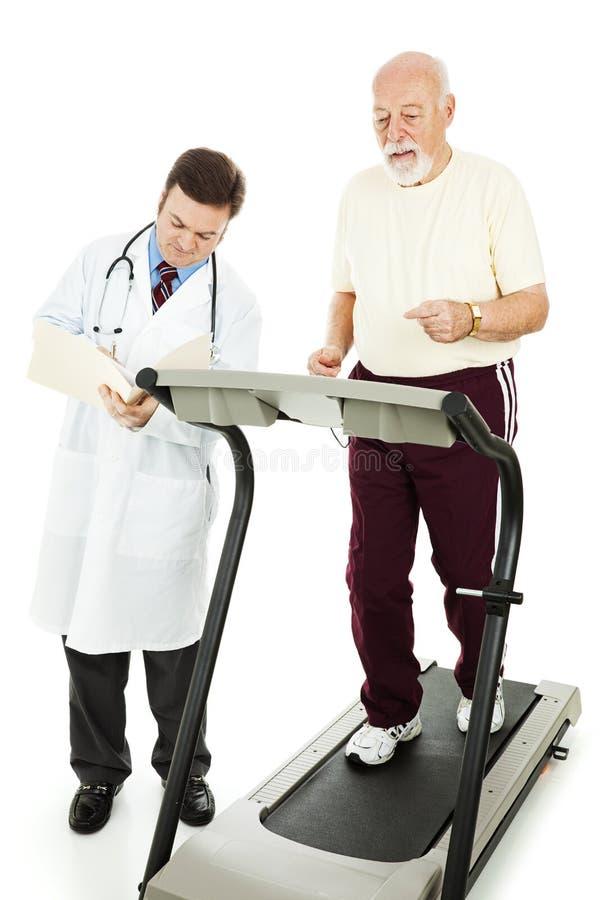 Homem sênior - exercício monitorado fotografia de stock