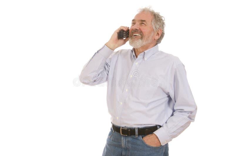 Homem sênior no telefone fotografia de stock