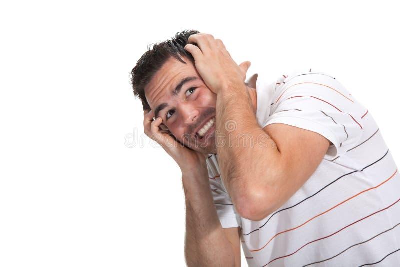 Homem Scared com mãos na cabeça imagens de stock