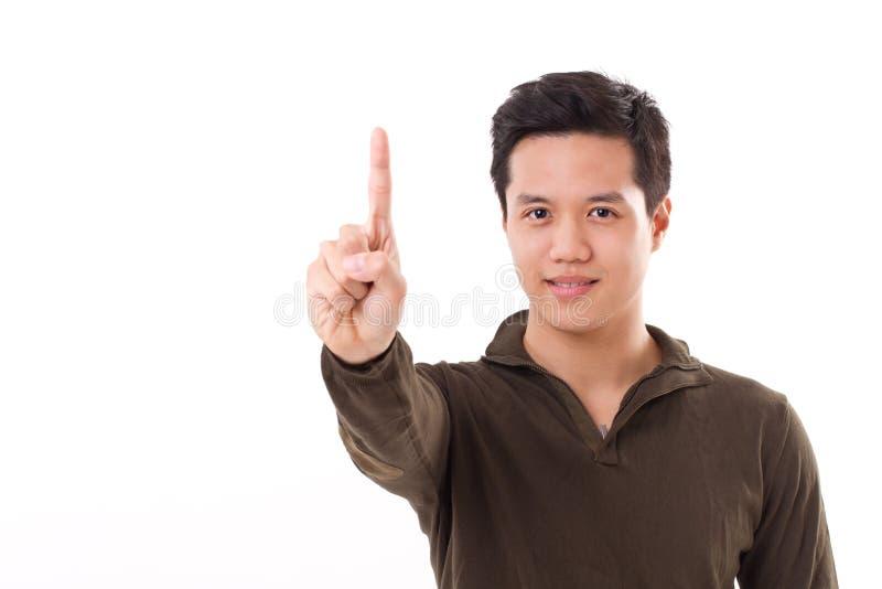 Homem seguro que aponta acima, mostrar nenhum 1 gesto no fundo branco fotografia de stock royalty free