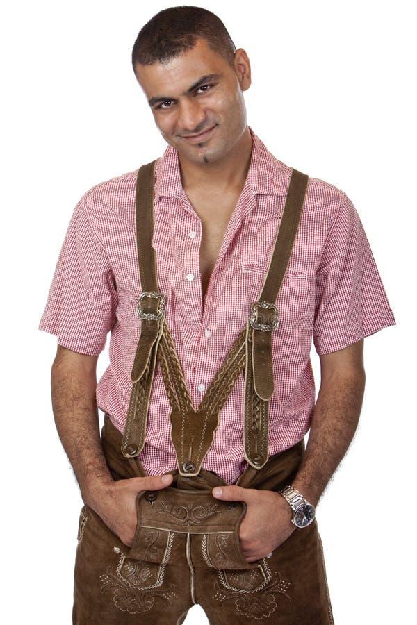 Homem 'sexy' com as calças de couro de Oktoberfest fotos de stock